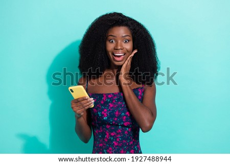 surprised young woman in black dresss reading news in magazine stock photo © deandrobot