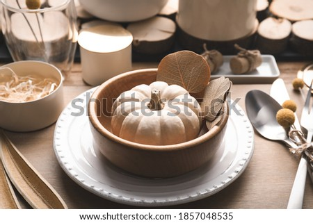 Dinnerware setting for autumn holidays on rustic wooden boards Stock photo © tab62