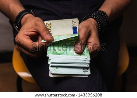 Stock photo: Female hands counting large amount of euro currency cash banknot