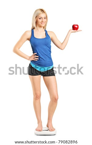 Full length of smiling sportswoman standing and holding basketball ball Stock photo © deandrobot