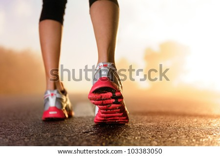 Runner feet running on road closeup on shoe. Woman fitness jog w Stock photo © Yatsenko