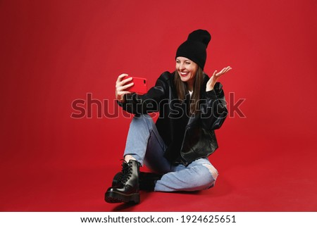 full body picture of a woman in leather jacket smiling Stock photo © feedough