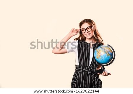 Happy young woman in glasses writing advertisement on bulletin board Stock photo © deandrobot