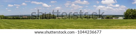 landscape in the Hunsrueck with wind generators and sun collect Stock photo © meinzahn