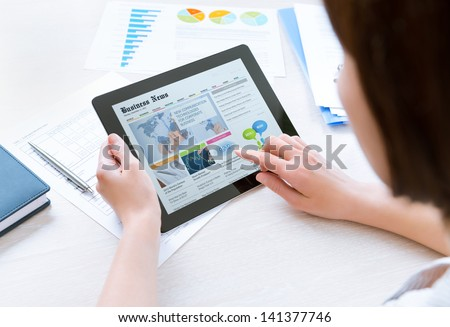 businesswoman using tablet device tablet computer touch screen f Stock photo © NikoDzhi