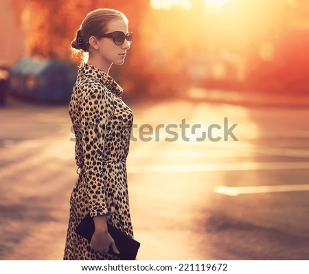 pretty stylish woman in fashion dress with leopard print together in luxury rich room interior life stock photo © iordani