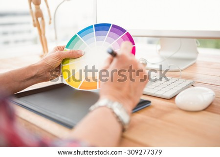 Close up view of hands working with digtizer and colour chart Stock photo © wavebreak_media