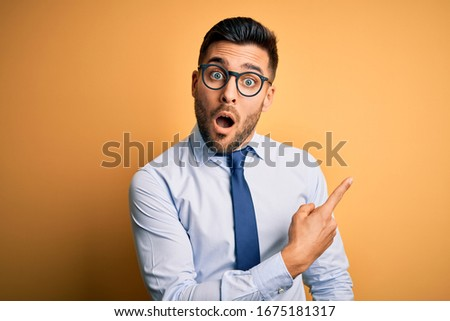 Shocked bearded businessman with open mouth looking at camera Stock photo © LightFieldStudios