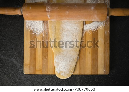 Directly above shot of wooden rolling pin on dough over cutting board Stock photo © wavebreak_media