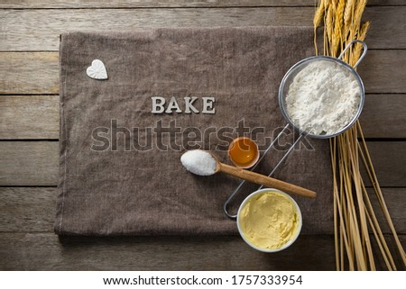 Wheat stem, wear flour, sieve, spoon placed over a cloth on wooden table Stock photo © wavebreak_media