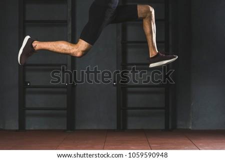 Kép izmos fiatal sportoló kardio futópad Stock fotó © deandrobot
