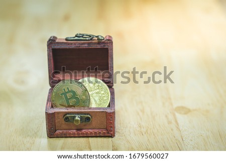 Bitcoin chest. Treasures are crypto currency. Old wood Box Virtu Stock photo © MaryValery