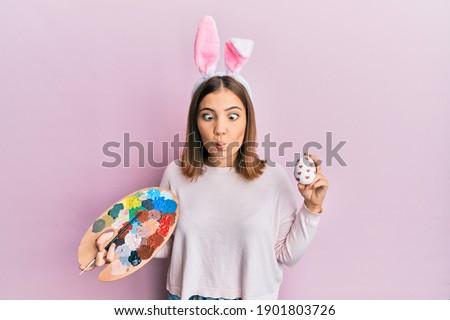 Güzel genç kadın tavşan kulaklar lolipop Stok fotoğraf © orensila