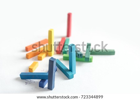 Group colored pastel chalks in a chaotic manner with selective f Stock photo © deandrobot