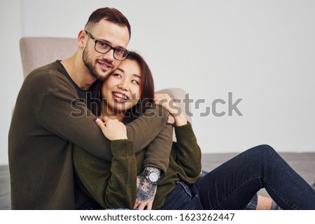 young couple together. guy with tattoo, girlfriend wearing dreadlocks Stock photo © iordani