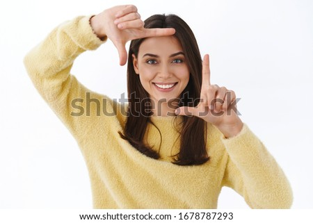 Horizontal photo of pleased educated woman smiling and demonstra Stock photo © deandrobot