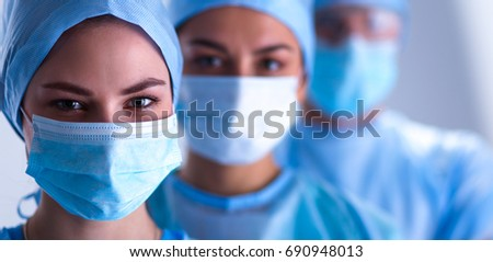 Female and male surgeon wearing surgical mask in operation theater Stock photo © wavebreak_media