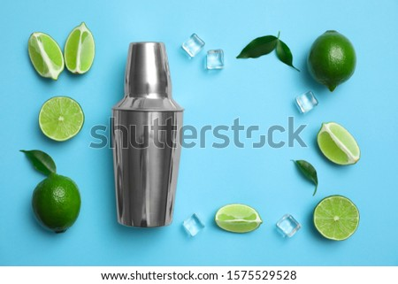 flat lay exotic citrus fruits with green leaves on a blue paper stock photo © artjazz