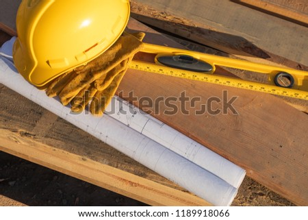 abstract of constrcution hard hat gloves level and house plans stock photo © feverpitch