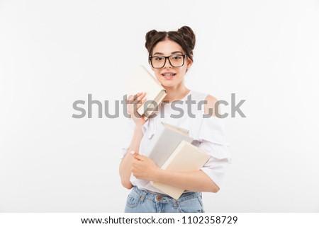 portrait closeup of beautiful teenage girl 20s with double buns stock photo © deandrobot