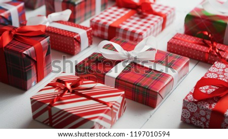 Side view of wrapped Christmas presents laid on the wooden table Stock photo © dash