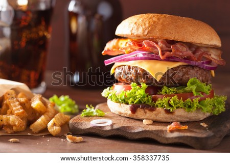 Fresh beef burger with sauce and vegetables and glass of cola soft drink with potato chips fries on  Stock photo © DenisMArt
