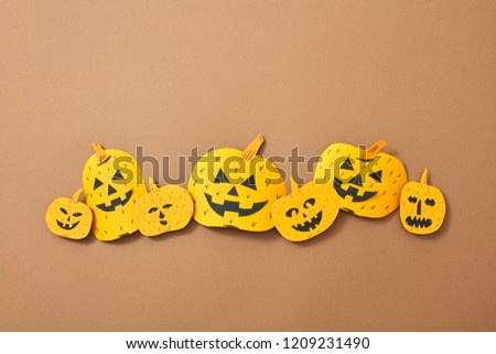 Different handcraft scary pumpkins and bats on a brown background with space for text. Creative comp Stock photo © artjazz