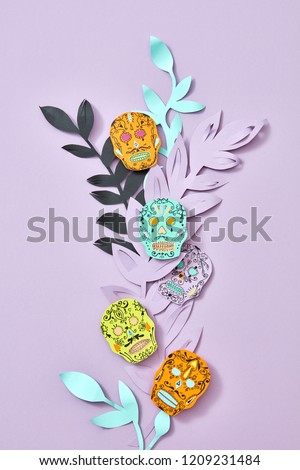 The pattern of handcraft paper Calaveras attribute of the Mexican holiday of Calaca and colored leav Stock photo © artjazz