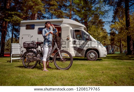 Woman on electric bike resting at the campsite VR Caravan car Va Stock photo © cookelma