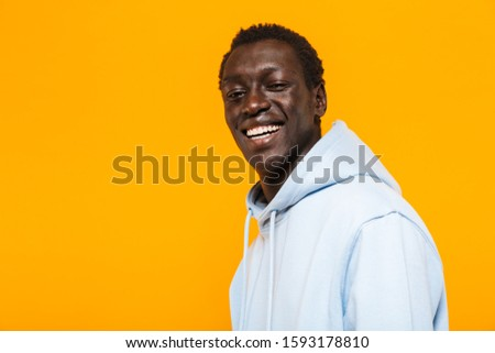 portrait of joyous african american man with stylish afro hairdo stock photo © deandrobot