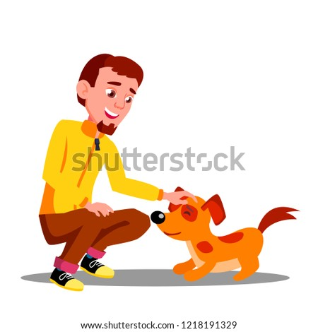 Teen Guy Volunteer Feeding Dog In Shelter Vector. Isolated Illustration Stock photo © pikepicture