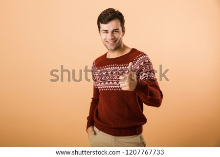 Image of unshaved man 20s with bristle wearing knitted sweater s Stock photo © deandrobot
