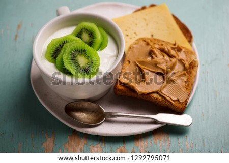 Natural yoghurt with kiwi and peanut butter toast. healthy breakfast Stock photo © zoryanchik