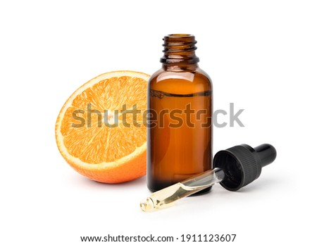 Bottles of essential oil with fresh tangerines and lemons, melissa, frankincense and other ingredien Stock photo © madeleine_steinbach