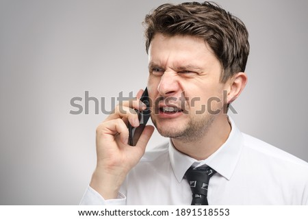 Furious Business Man Screaming On Cell Phone In Office Restroom Stock photo © diego_cervo