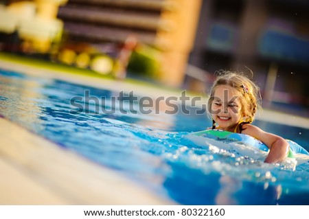 pretty little girl swimming in outdoor pool and have a fun with inflatable circle stock photo © galitskaya