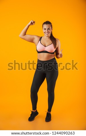 Full length portrait of caucasian chubby woman in sportive bra t Stock photo © deandrobot