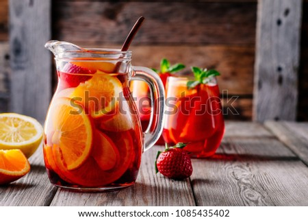 Glass jug of iced sangria with strawberry, orange, apple and lem Stock photo © dashapetrenko