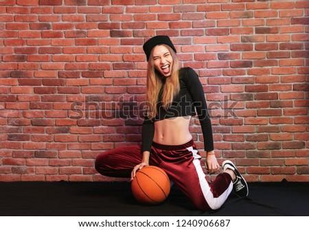 Fotó izgatott lány 20-as évek ül padló Stock fotó © deandrobot