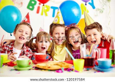 Group of adorable kids having fun at birthday party with mother stock photo © Lopolo