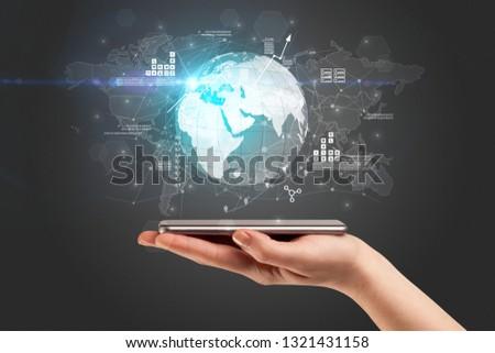 Hand using phone  with worldwide reports links and statistics co Stock photo © ra2studio