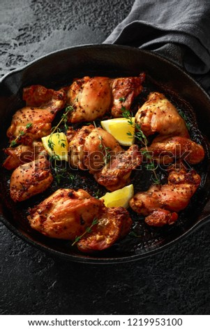 Grilled chicken legs with rosemary served on white plate. Dinner background stock photo © Virgin