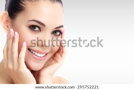 Pretty woman against a grey background with copyspace. Skin care Stock photo © Nobilior