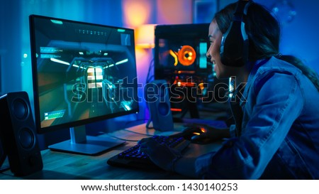 Joyful young woman playing computer games with virtual reality g Stock photo © boggy