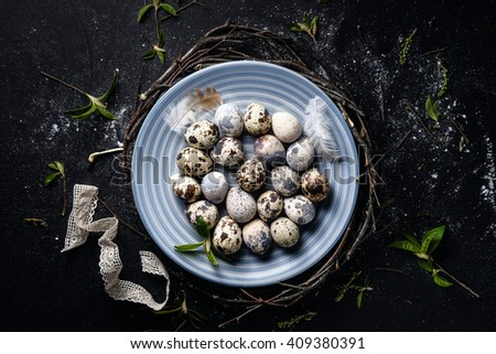 Quail eggs in a nest on a black rustic wooden background. Easter symbols Stock photo © dash