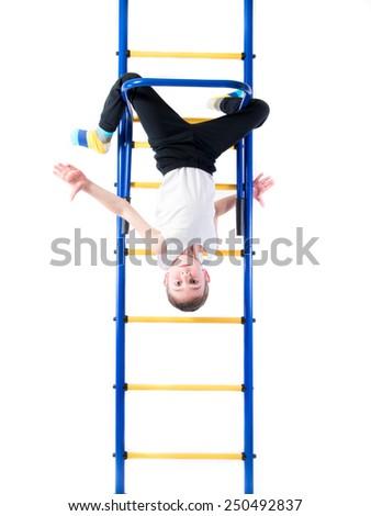 sporty little boy hanging on horizontal bar upside down vector flat cartoon illustration stock photo © pikepicture