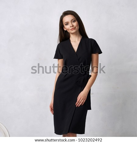 Stúdió portré barna hajú lány este fekete ruha Stock fotó © studiolucky