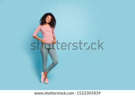 Full length photo of cheerful afro american lady wearing green d Stock photo © deandrobot