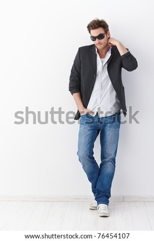 Photo of handsome adult man 30s wearing casual clothing drinking Stock photo © deandrobot