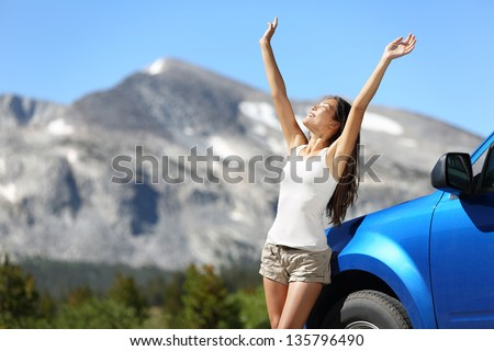 Summer car travel freedom woman in Yosemite National Park with arms raised up cheerful and happy. Su Stock photo © ElenaBatkova